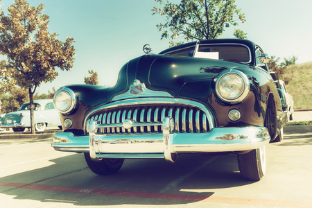 grille: WESTLAKE, TEXAS - OCTOBER 18, 2014: A 1947 Buick Super Sedanette is on display at the 4th Annual Westlake Classic Car Show. Front view. Vintage style effects.
