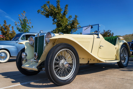 grille: WESTLAKE, TEXAS - OCTOBER 18, 2014: A yellow 1947 MG TC Roadster is on display at the 4th Annual Westlake Classic Car Show. Front side view.