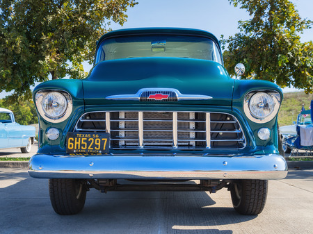 front of: WESTLAKE, TEXAS - OCTOBER 18, 2014: A green 1956 Chevrolet 3100 pickup truck is on display at the 4th Annual Westlake Classic Car Show. Front view.