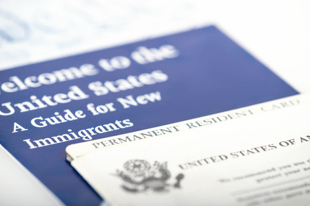 illegal immigrant: United States of America permanent resident card, green card. Immigration concept. Closeup with shallow depth of field.