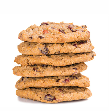 oatmeal cookie: Stack of homemade cranberry oatmeal raisin cookies on white background