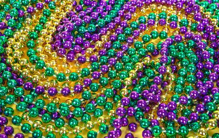カラフルなマルディグラのビーズの背景 写真素材