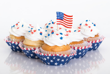Patriotic cupcakes with sprinkles and American flag photo