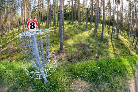 disc golf: Disc golf hole in the woods. Fisheye capture.
