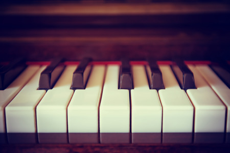 Piano keyboard closeup with shallow depth of field. Vintage filter effects.