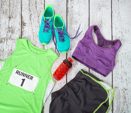 Running gear laid out ready for a race day, rustic wooden background
