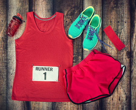 head gear: Running gear laid out ready for a race day, rustic wooden background
