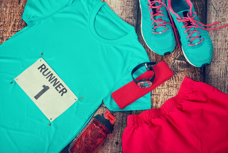 sports gear: Running gear laid out ready for a race day, rustic wooden background