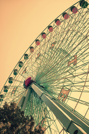 DALLAS, TX, - August 16, 2015: Texas Star, the largest ferris wheel in North America, rises above the horizon at Fair Park in Dallas, Texas. Vintage filter effects. Editorial