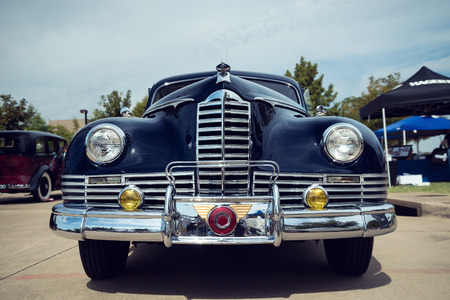 custom car: WESTLAKE, TEXAS - OCTOBER 17, 2015: Front view of a dark blue 1947 Packard Custom Coupe classic car.