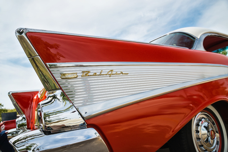 chevrolet: WESTLAKE, TEXAS - OCTOBER 17, 2015: Tail fin and taillight details of a red 1957 Chevrolet Bel Air classic car.