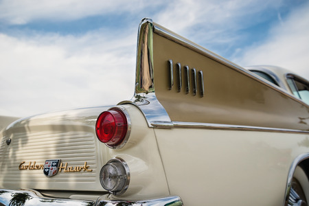 fifties: WESTLAKE, TEXAS - OCTOBER 17, 2015: Tail fin and taillight details of a 1957 Studebaker Golden Hawk classic car.