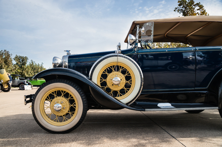 classic car: WESTLAKE, TEXAS - OCTOBER 17, 2015: Side view of a 1931 Ford Phaeton Convertible Classic Car.