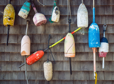 buoys: Old weathered lobster buoys hanging on the wall