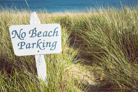 No parking sign on the beach. Environmental concept.