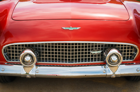 grille: WESTLAKE, TEXAS - OCTOBER 17, 2015: Front details and grille of a red 1956 Ford Thunderbird Convertible classic car. Editorial