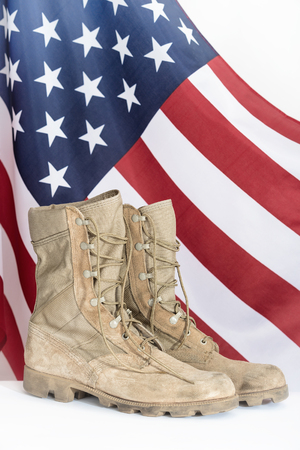 combat boots: Old combat boots with American flag in the background