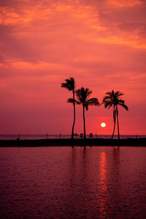 big island: Hawaiian Sunset on Big Island Anaehoomalu Bay. Copy space.