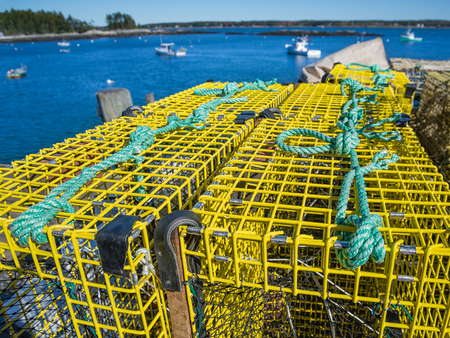 Lobster traps at a fishing pier in coastal Maine, New England Stock Photo