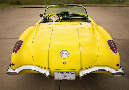 Westlake, Texas - October 21, 2017: A rear view of a yellow 1958 Corvette Chevrolet classic car.