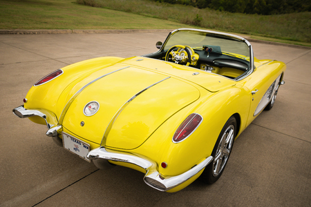 Westlake, Texas - October 21, 2017: A back side view of a yellow 1958 Corvette Chevrolet classic car. Editorial
