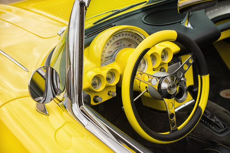 Westlake, Texas - October 21, 2017: Dashboard and steering wheel interior view of a yellow 1958 Corvette Chevrolet convertible classic car.