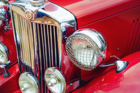 Westlake, Texas - October 21, 2017: Closeup of headlights and the grille of a red 1951 MG TD classic car. Editorial