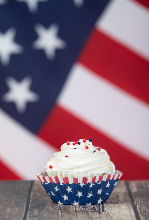 Patriotic 4th of July or Memorial Day celebration cupcake. The American flag in the background.