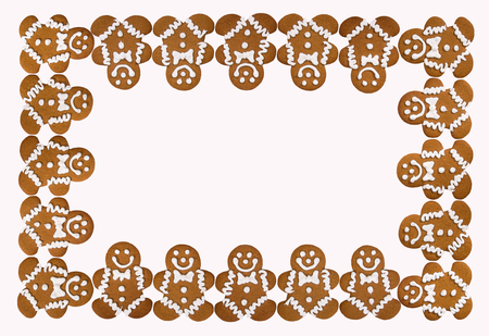 Holiday Christmas theme border of Gingerbread Men cookies. Imagens