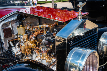 Westlake, Texas - October 20, 2018: Beautiful engine details of a red 1923 Rolls-Royce Silver Ghost Piccadilly Roadster classic car.