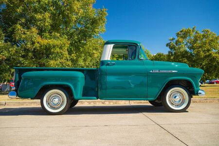 WESTLAKE, TEXAS - OCTOBER 19, 2019: Full side view of a green vintage 1956 Chevrolet Apache 3100 classic truck.