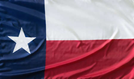 State Flag of Texas on waving fabric texture Stock Photo