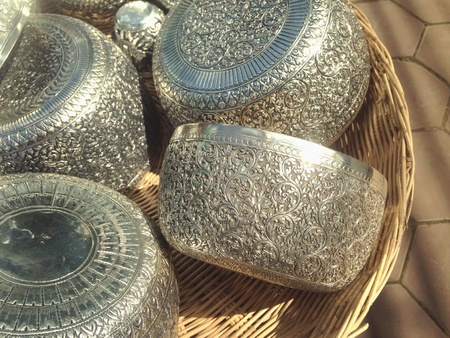 silver: Close up to some silver bowl in a bamboo basket