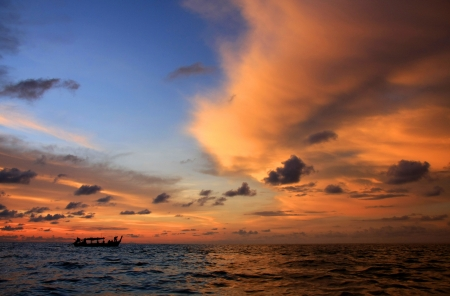 Fisherman boat with sunset sky, Thailand   photo