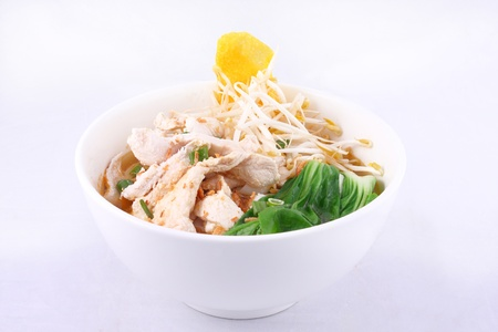 Chicken clear noodle soup with wonton   Stock Photo