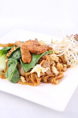 Asian stir fried flat rice noodles  Pad se ew with chicken