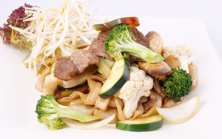 Flat rice noodle stir fried with oyster sauce and vegetable photo