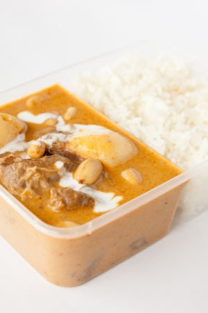 Thai take away food, massaman curry with rice  photo