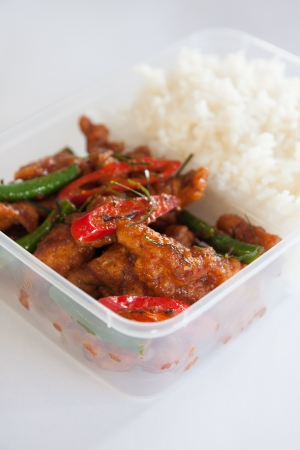 Thai take away food, stir fried chicken with rice  photo