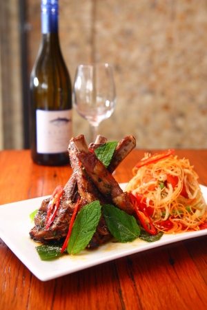 Grill lamb with papaya salad