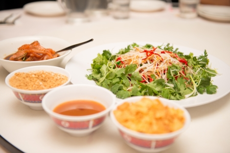 known: Raw fish salad  also known as Yu Sheng or Lo Hei , a Chinese New year Stock Photo