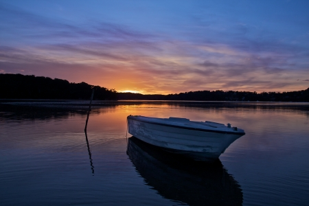 Boat in lake with sunset light  photo
