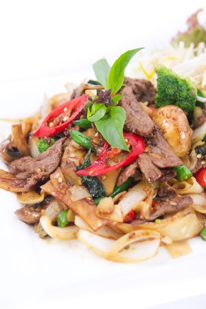 Stir fried flat rice noodles with basil sauce   photo