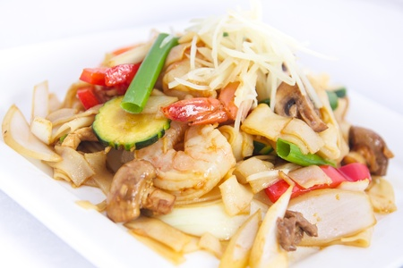 Stir fried flat rice noodles with ginger sauce   photo