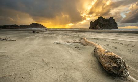 Stuning sunset at Wharariki beach, New Zealand.