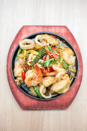 sizzling: Seafood sizzling with Thai herbs. Stock Photo