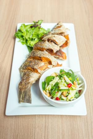 mango fish: Deep fried fish with Thai mango salad