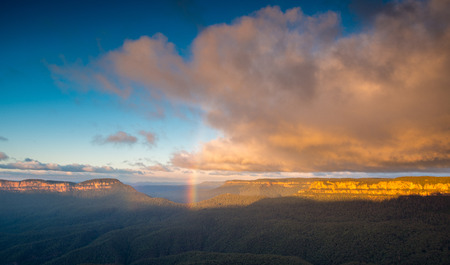 Rainbow in Blue Mountains national park Australia Stock Photo