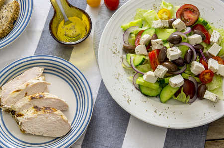 Greek salad fresh vegetables and fetta cheese Stock Photo