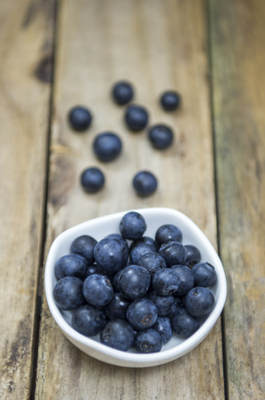 Group of blueberries on wooden table